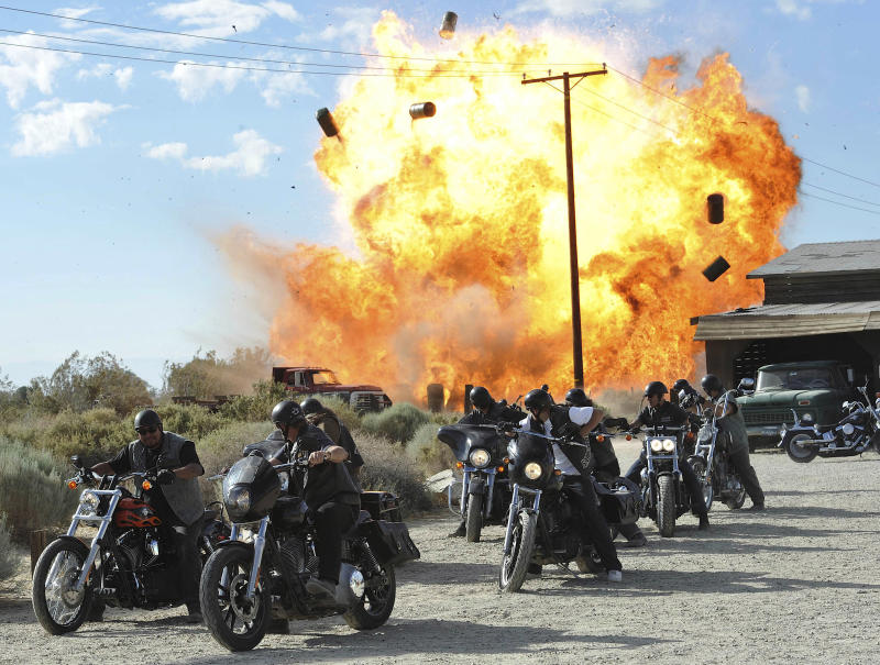 "FILE - In this file image released by FX, a scene is shown from the FX original series, ""Sons of Anarchy."" Television executives who spoke to the media recently about the tragic shootings in Newtown, Conn., and Aurora, Colo., say the events bothered them, but none offered concrete examples of how it is changing what they put on the air, or if that is necessary. FX President John Landgraf said he was in favor of further study about any correlation between entertainment and real violence. Landgraf pointed out that the zombie series ""Walking Dead"" and brutally violent ""Sons of Anarchy"" are both very popular in England and that country has far fewer gun murders than the United States. (AP Photo/FX, Prashant Gupta, File)"
