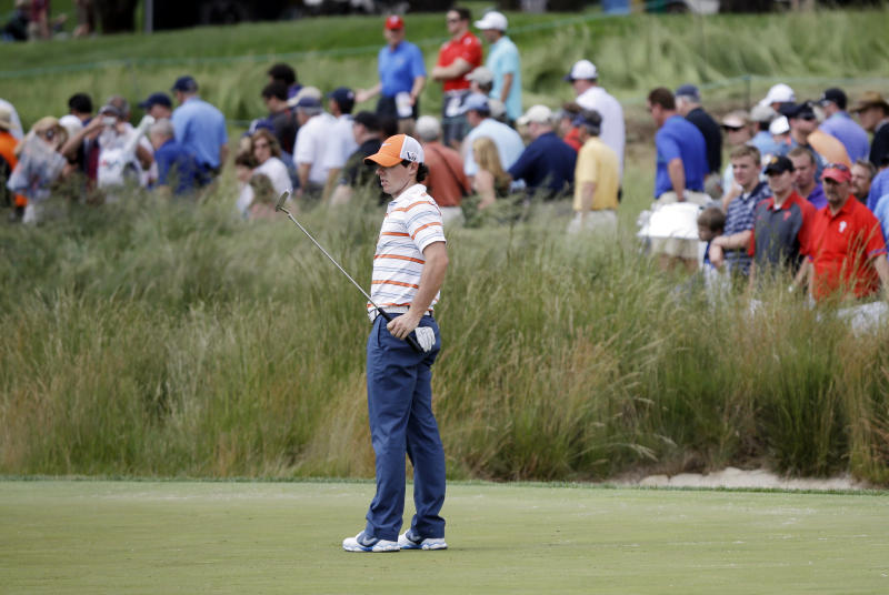 Rory McIlroy, of Northern Ireland, watches his putt on the fourth green during practice for the U.S. Open golf tournament at Merion Golf Club, Tuesday, June 11, 2013, in Ardmore, Pa. (AP Photo/Morry Gash)