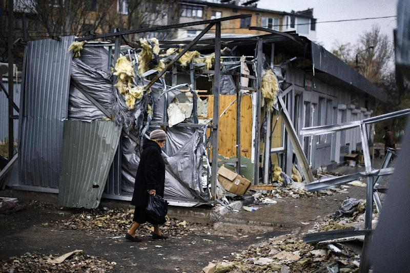 A woman walks past destroyed shops in the Kuybeshevski area of Donetsk, eastern Ukraine, on November 1, 2014 (AFP Photo/Dimitar Dilkoff)