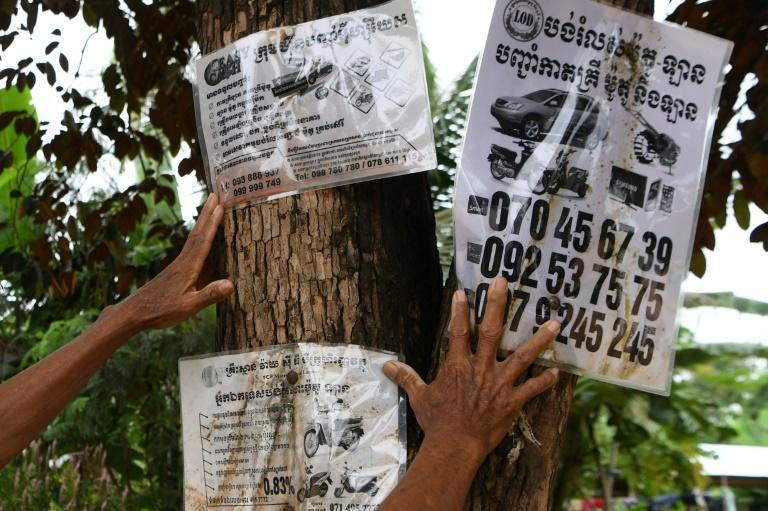Flyers advertise microfinance services in a village in Siem Reap province, Cambodia