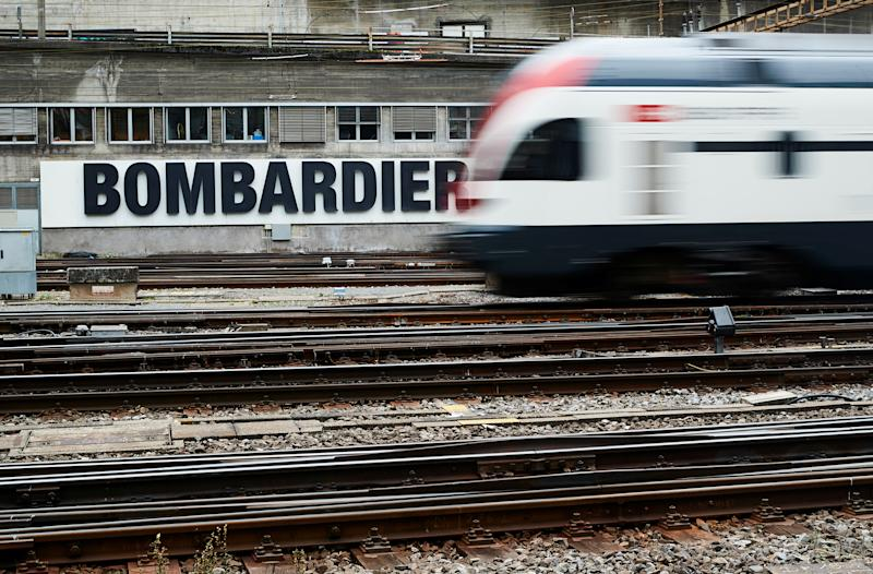A Bombardier advertising board is pictured in front of a SBB CFF Swiss railway train at the station in Bern, Switzerland, October 24, 2019. REUTERS/Denis Balibouse