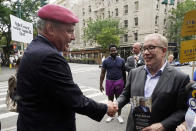 Republican candidate for New York mayor Curtis Sliwa, left, shakes hands with Democrat mayoral candidate Scott Stringer, in New York, Tuesday, June 22, 2021. The final votes are set to be cast Tuesday in New York's party primaries, where mayors, prosecutors, judges and city and county legislators will be on the ballot, along with other municipal offices. (AP Photo/Richard Drew)