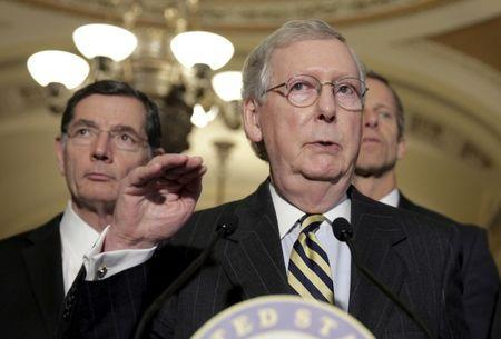 Senate Majority Leader Mitch McConnell (R-KY) speaks during a news conference as Senator John Barrasso (R-WY) listens on Capitol Hill in Washington