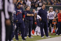 New England Patriots head coach Bill Belichick, center left, watches his team play during the first half of an NFL football game against the New York Jets, Monday, Oct. 21, 2019, in East Rutherford, N.J. (AP Photo/Adam Hunger)