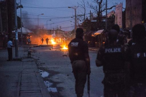 Madagascar riot police use rubber bullets to disperse protesters who are angry after police officers beat up a Toamasina resident who refused to respect the virus lockdown in Madagascar