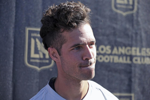 FILE - In this Jan. 22, 2018, file photo, LAFC's Benny Feilhaber talks to reporters during the introduction of players and coaches at the MLS soccer club's first training camp in Los Angeles. Midfielder Benny Feilhaber retired from soccer on Wednesday, March 11, 2020, after a career that included playing for the United States at the 2010 World Cup and nine years in Major League Soccer. (AP Photo/Reed Saxon, File)