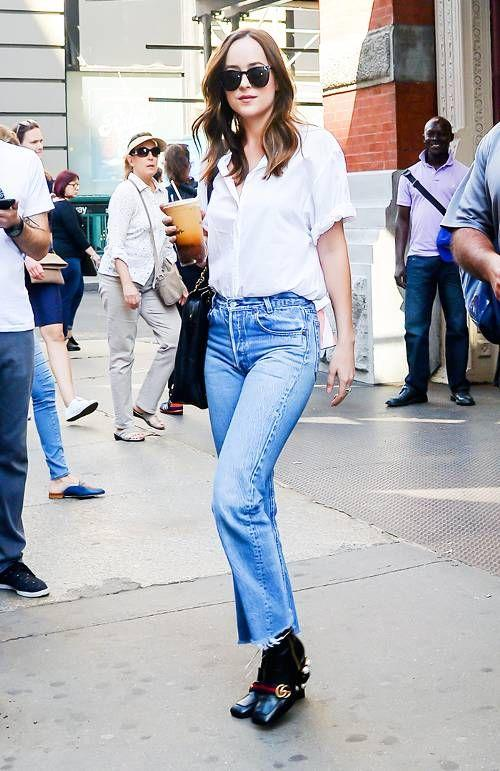 Style Notes: Dakota could carry off any jean she likes, but like many of us, she seldom deviates from high-waist, straight-leg styles in vintage-wash blue.