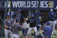 Members of the Tampa Bay Rays warms up during batting practice before Game 1 of the baseball World Series against the Los Angeles Dodgers Tuesday, Oct. 20, 2020, in Arlington, Texas. (AP Photo/Eric Gay)