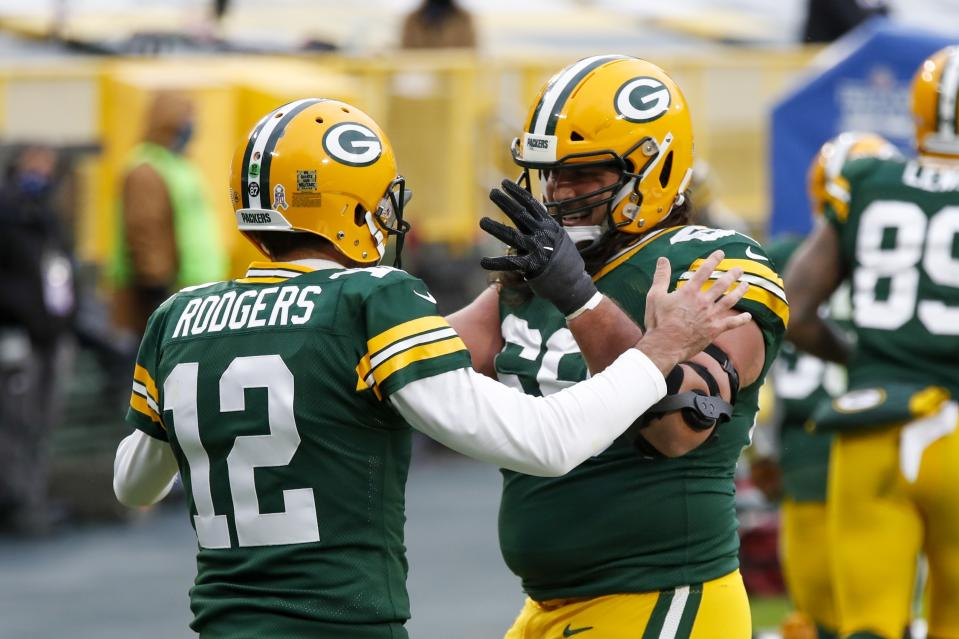 Green Bay Packers' Aaron Rodgers celebrates his touchdown run with David Bakhtiari during the first half of an NFL football game against the Jacksonville Jaguars Sunday, Nov. 15, 2020, in Green Bay, Wis. (AP Photo/Matt Ludtke)