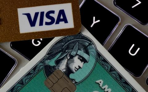 Visa and American Express credit cards on a computer keyword - Credit: Philippe Wojazer/Reuters