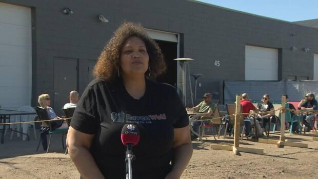 RavenWolf Brewing Company, owned by Jan Gillett and her husband, set up a patio in the back alley behind the microbrewery with furniture donated by the local community. (Craig Ryan/CBC - image credit)