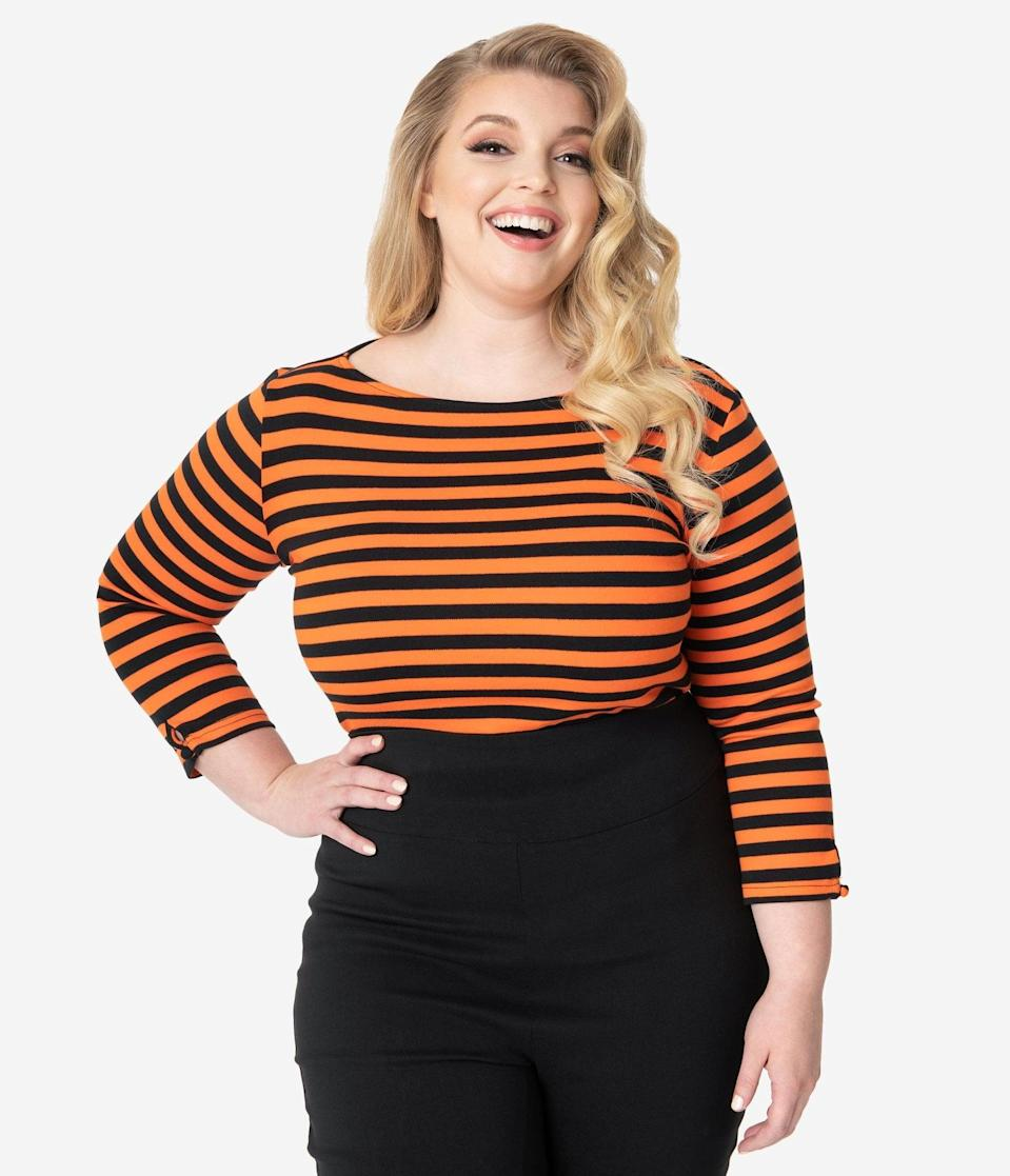 "<p>Subtle and spooky, the <span>Unique Vintage Plus Size Black and Orange Stripe Knit Three-Quarter Sleeve Gracie Top</span> ($58) will complement any <a class=""link rapid-noclick-resp"" href=""https://www.popsugar.com/Halloween"" rel=""nofollow noopener"" target=""_blank"" data-ylk=""slk:Halloween"">Halloween</a> look. </p>"