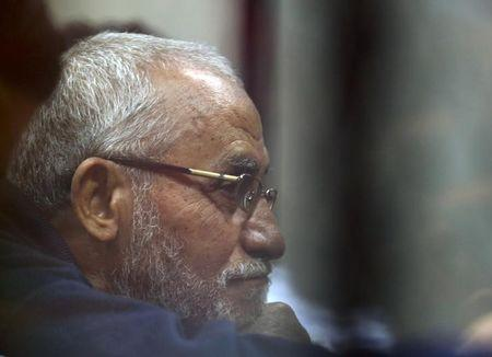 Muslim Brotherhood's Supreme Guide Mohamed Badie listens to lawyers as he sits behind bars during his trial with ousted Egyptian President Mohamed Mursi and other leaders of the brotherhood at a court in the police academy on the outskirts of Cairo December 14, 2014. REUTERS/Asmaa Waguih