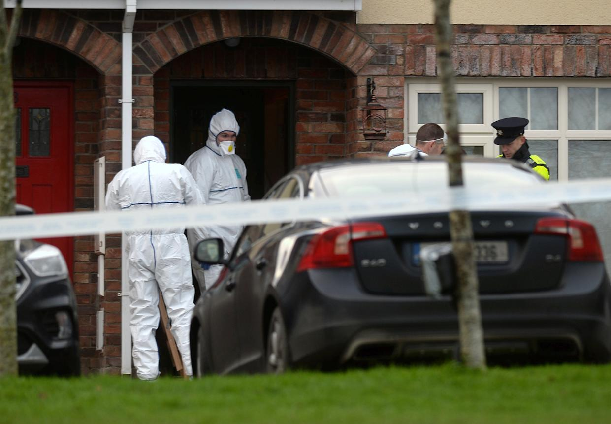 Garda forensics at a house in the village of Newcastle, south west of Dublin city where three children were found dead on Friday.