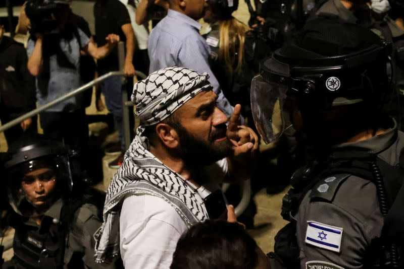 FILE PHOTO: A Palestinian man gestures as he argues with an Israeli border policeman by the entrance to Jerusalem's Old City