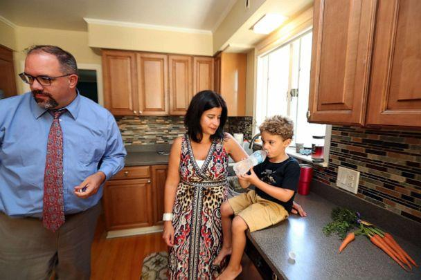 PHOTO: Michigan State senator Jim Ananich at home with his wife, Andrea Ananich and 4 year old son Jacob Ananich, Aug. 27, 2019, in Flint, Mich. (Fabrizio Costantini for ABC News)