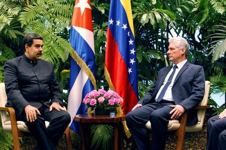 Cuban President Miguel Diaz-Canel (R) speaks to Venezuela's President Nicolas Maduro at the Revolution Palace in Havana, Cuba April 21, 2018. Ernesto Mastrascusa/Pool via Reuters