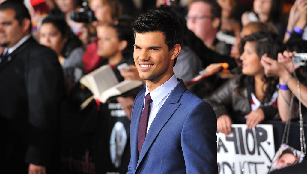 Taylor Lautner is all smiles at the red carpet premiere for 'The Twilight Saga: Breaking Dawn – Part 1' in Los Angeles, CA. (Photo by Vince Bucci/Yahoo!)