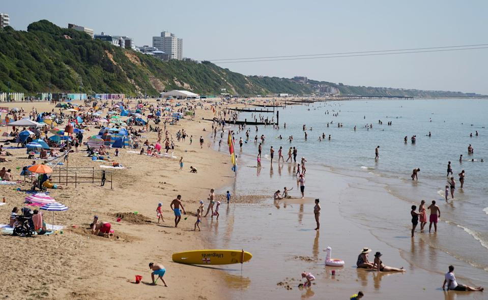 People enjoying the hot weather at Bournemouth Beach in Dorset (PA)