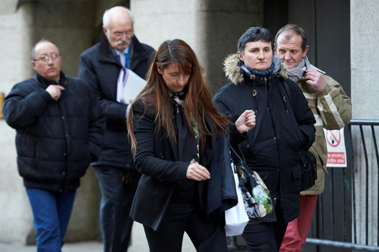 The family of murdered French au-pair Sophie Lionnet leave court in London, where her compatriot employers are on trial accused of burning her body in a bonfire