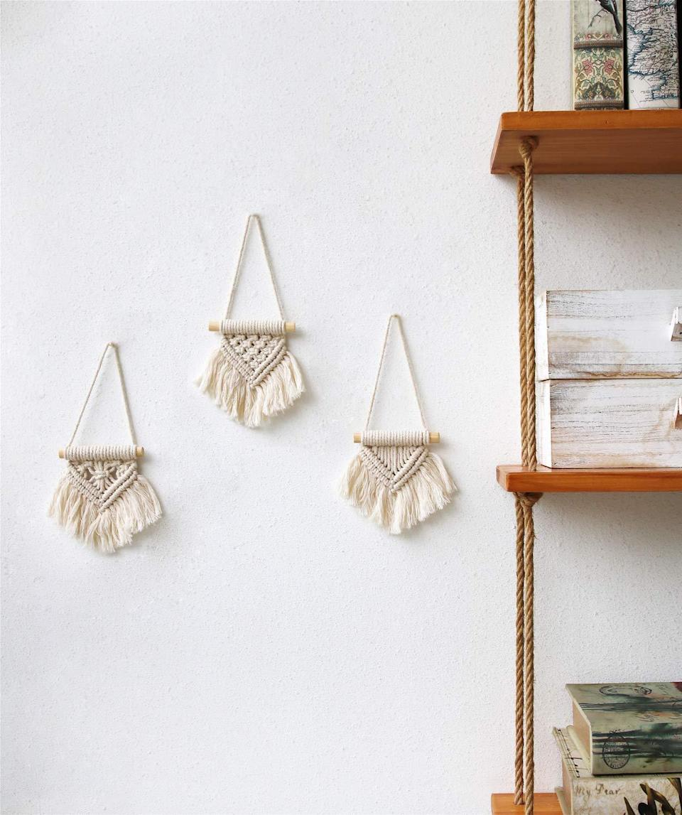 "<h3><a href=""https://amzn.to/2PoVv1A"" rel=""nofollow noopener"" target=""_blank"" data-ylk=""slk:Mini Macrame Tapestry Trio"" class=""link rapid-noclick-resp"">Mini Macrame Tapestry Trio</a> </h3><br>Bless a boho-chic someone in your life with this sweet little trio of mini macrame tapestries that can serve as wall accents or holiday ornaments. <br><br><strong>Mkono</strong> Mini Macrame Wall Hanging Set, $, available at <a href=""https://amzn.to/2PoVv1A"" rel=""nofollow noopener"" target=""_blank"" data-ylk=""slk:Amazon"" class=""link rapid-noclick-resp"">Amazon</a>"