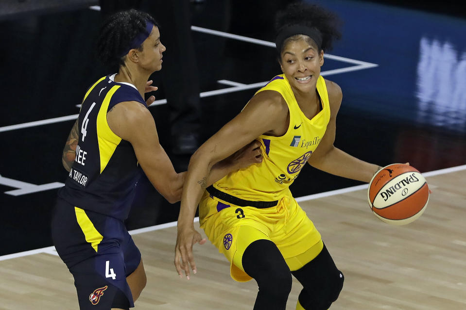 Los Angeles Sparks forward Candace Parker (3) goes to the basket against Indiana Fever forward Candice Dupree (4) during the first half of a WNBA basketball game Wednesday, Aug. 5, 2020, in Bradenton, Fla. (AP Photo/Chris O'Meara)