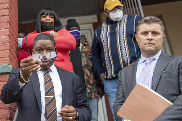 Attorney's for the Wallace family, Shaka Johnson, left, and Kevin P. O'Brien, right, speak to the media outside Walter Wallace Jr.'s home in Philadelphia, Pa., Tuesday, Oct. 27, 2020. Police officers fatally shot Wallace, a 27-year-old Black man armed with a knife during a confrontation the day before, an incident that quickly raised tensions in the neighborhood and sparked a standoff that lasted deep into the night. (Jose F. Moreno/The Philadelphia Inquirer via AP)