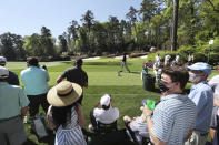 The small gallery of patrons watches Phil Mickelson tee off on the 14th hole during his practice round for the Masters at Augusta National Golf Club on Tuesday, April 6, 2021, in Augusta, Ga. (Curtis Compton/Atlanta Journal-Constitution via AP)