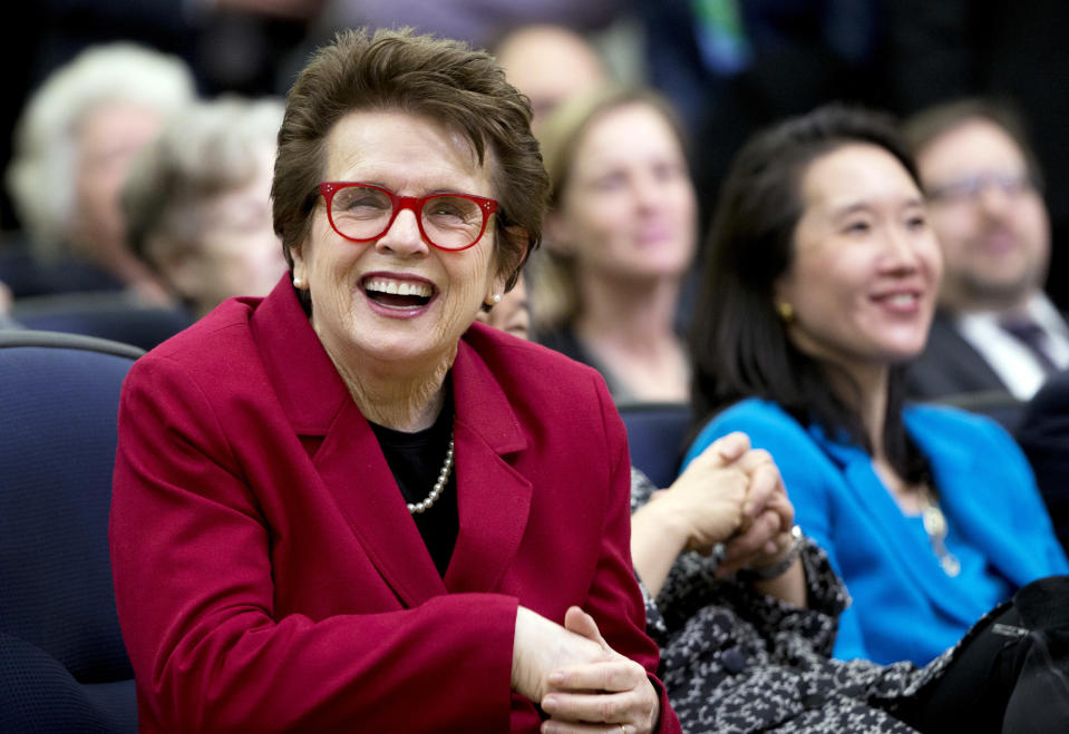 FILE - In this Jan. 29, 2016, file photo, tennis great Billie Jean King, left, laughs, reacting to President Barack Obama's remarks in the Eisenhower Executive Office Building on the White House complex in Washington.  Billie Jean King and partner Ilana Kloss have joined the Los Angeles Dodgers ownership group. The Dodgers made the announcement Thursday, Sept. 20, 2018. The tennis great says Dodgers owner and chairman Mark Walter and the organization have proven to be leaders in sports on and off the field.  (AP Photo/Manuel Balce Ceneta, File)