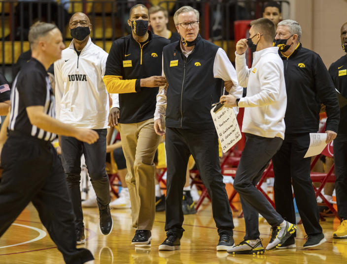 Iowa head coach Fran McCaffery is restrained by members of the team's staff after he was called for a technical foul during the first half of an NCAA college basketball game against Indiana, Sunday, Feb. 7, 2021, in Bloomington, Ind. (AP Photo/Doug McSchooler)
