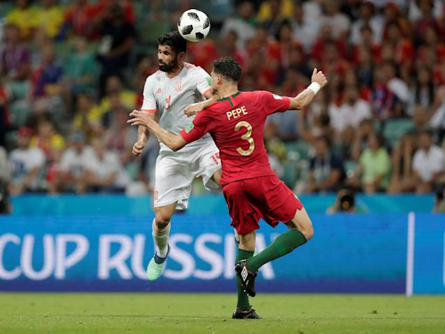 Soccer Football - World Cup - Group B - Portugal vs Spain - Fisht Stadium, Sochi, Russia - June 15, 2018 Spain's Diego Costa in action with Portugal's Pepe REUTERS/Ueslei Marcelino