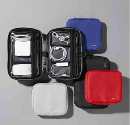 """<p>""""As a frequent traveler, staying organized is essential. And the more gadgets I travel with, the more cords and chargers I have to keep in order. All those wires have the potential to turn into one huge tangled mess! I'd love to find a <a href=""""http://www.skitsproducts.com/store/c/34-Smart-Tech-Cases.aspx"""">SKITS Smart Tech Case</a> under the tree this Christmas. Anything that helps me stay organized, helps me stay sane and makes travel that much easier and more enjoyable.""""<br /><i>— Natalie DiScala, Editor of <a href=""""http://www.ohtravelissima.com/"""">Oh! Travelissima</a></i></p>"""