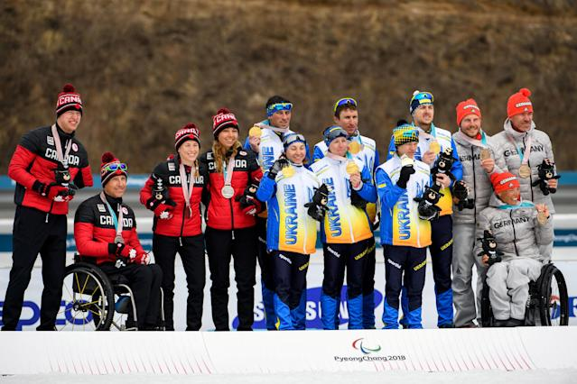 Team Canada (silver), Team Ukraine (gold) and Team Germany (bronze) pose on the podium of the Cross Country Skiing 4x2.5km Mixed Relay at the Alpensia Biathlon Centre. The Paralympic Winter Games, PyeongChang, South Korea, Sunday 18th March 2018. OIS/IOC/Thomas Lovelock/Handout via Reuters