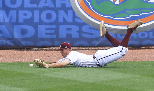 Texas A&M outfielder Zach Deloach makes a diving attempt to catch the fly ball of Mississippi's Will Golsan during the second inning of a Southeastern Conference tournament NCAA college baseball game, Saturday, May 26, 2018, in Hoover, Ala. Golson was later ruled out on a base running error. (AP Photo/Butch Dill)