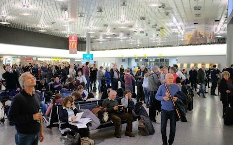 <span>Passengers inside Hannover airport wait for updates</span>