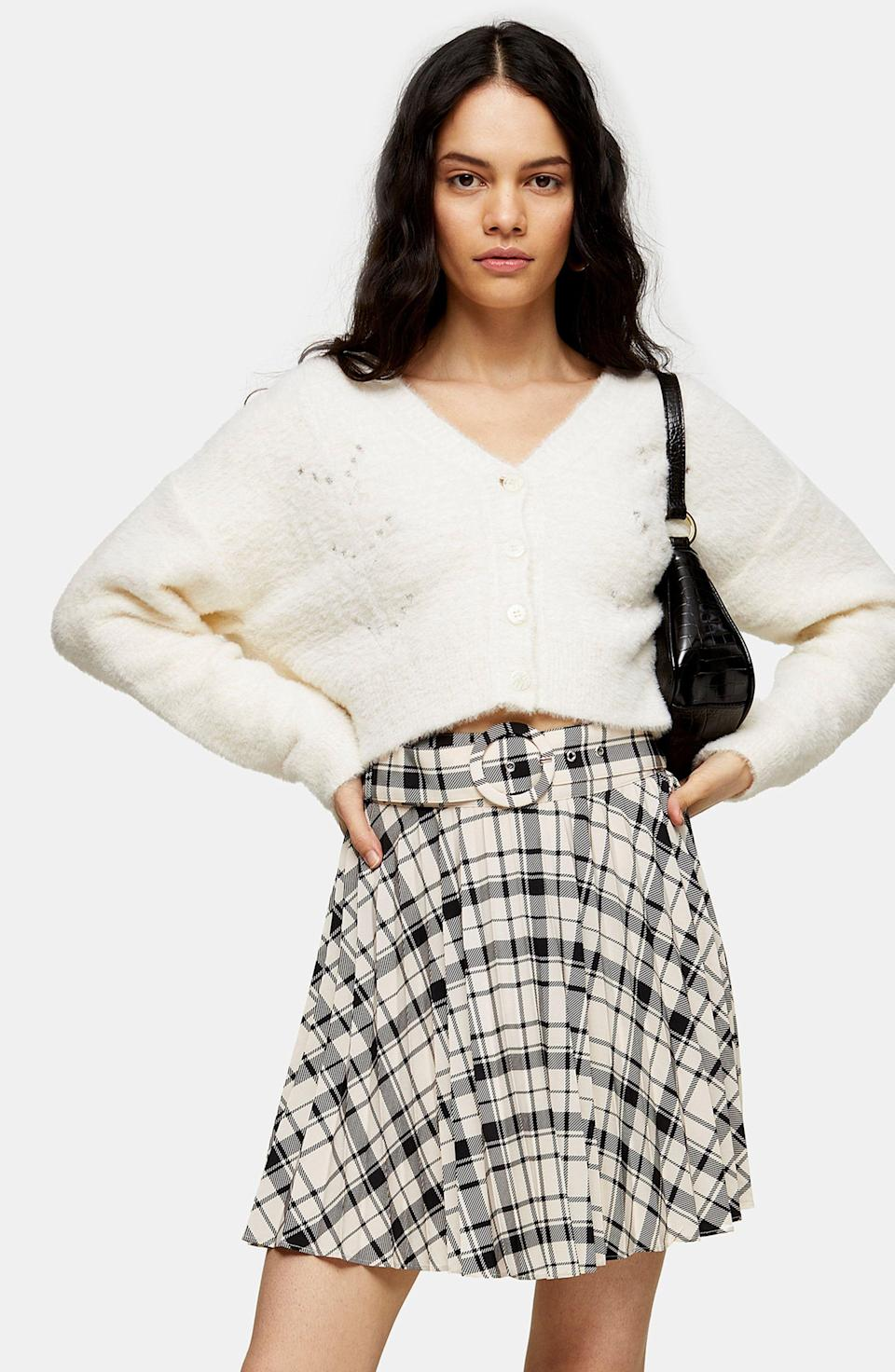 """<p><strong>TOPSHOP</strong></p><p>nordstrom.com</p><p><strong>$55.00</strong></p><p><a href=""""https://go.redirectingat.com?id=74968X1596630&url=https%3A%2F%2Fwww.nordstrom.com%2Fs%2Ftopshop-plaid-pleated-miniskirt%2F5619303&sref=https%3A%2F%2Fwww.goodhousekeeping.com%2Fclothing%2Fg33473194%2Ftransitional-clothing-summer-to-fall%2F"""" rel=""""nofollow noopener"""" target=""""_blank"""" data-ylk=""""slk:Shop Now"""" class=""""link rapid-noclick-resp"""">Shop Now</a></p><p>It's never too early to start donning plaid for the autumn season — especially if it's a cute mini skirt that you can easily transition from pairing with <a href=""""https://www.goodhousekeeping.com/clothing/g32106035/best-slip-on-sneakers/"""" rel=""""nofollow noopener"""" target=""""_blank"""" data-ylk=""""slk:summer sneakers"""" class=""""link rapid-noclick-resp"""">summer sneakers</a> to layering with some tights, boots, and a cozy sweater. </p>"""