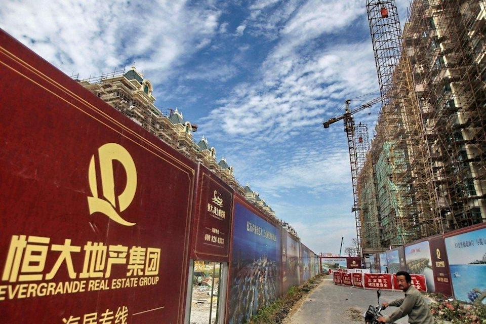 A billboard for China Evergrande Group's flagship Hengda Real Estate unit at a construction site in the Jiangsu provincial city of Qidong, near Nantong, on September 1, 2012.Photo: Imaginechina via AFP