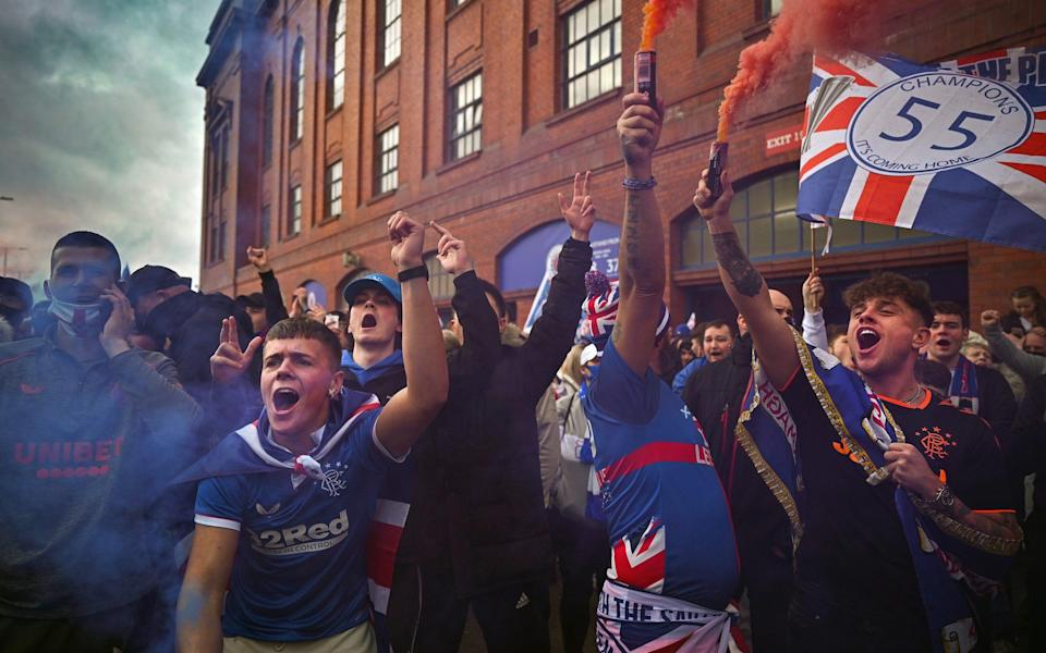 Rangers fans gather at Ibrox stadium to celebrate the club winning the Scottish Premiership for the first time in 10 years - Getty Images Europe