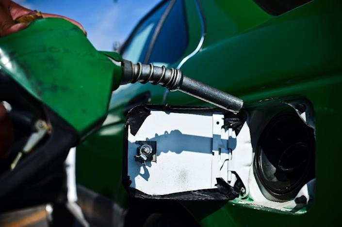 Rising US gasoline prices accounted for three-quarters of the increase in the CPI inflation measure in November, but prices for apparel and medical care declined (AFP Photo/RONALDO SCHEMIDT)