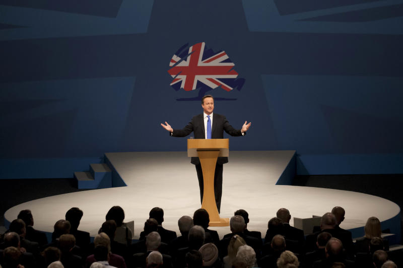 "British Prime Minister David Cameron delivers his speech on the final day of the Conservative Party Conference, Manchester, England, Wednesday, Oct. 2, 2013. Cameron says Britain is on the road to financial recovery, and his Conservative Party will unleash economic energy to make it ""a land of opportunity for all."" (AP Photo/Jon Super)"