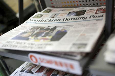 Copies of the South China Morning Post (SCMP) newspaper are seen on a newspaper stand in Hong Kong, China November 26, 2015.  REUTERS/Tyrone Siu