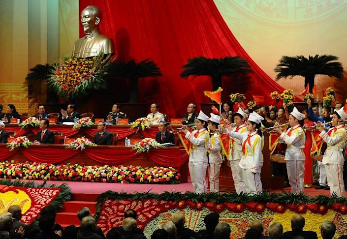 Communist Pioneers' league members play music to welcome delegates during the official opening ceremony of the VCP's 12th National Congress, in Hanoi, on January 21, 2016 (AFP Photo/Hoang Dinh Nam)