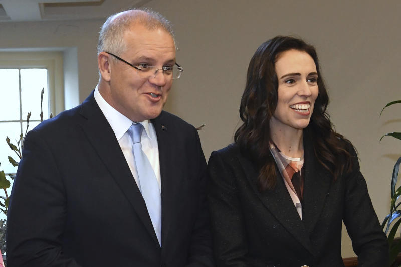 New Zealand's Prime Minister Jacinda Ardern, right, arrives with Australian Prime Minister Scott Morrison before bilateral talks in Melbourne, Australia, Friday, July 19, 2019. (Julian Smith/Pool Photo via AP)