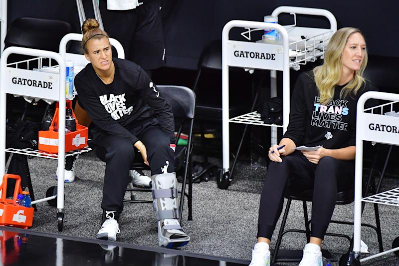 "Sabrina Ionescu in a black 'Black Lives Matter"" T-shirt and in an ankle boot."