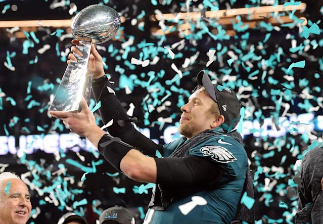 <p>Philadelphia Eagles quarterback Nick Foles (9) celebrates with the the Vince Lombardi Trophy after defeating the New England Patriots in Super Bowl LII at U.S. Bank Stadium. Mandatory Credit: Winslow Townson-USA TODAY Sports </p>