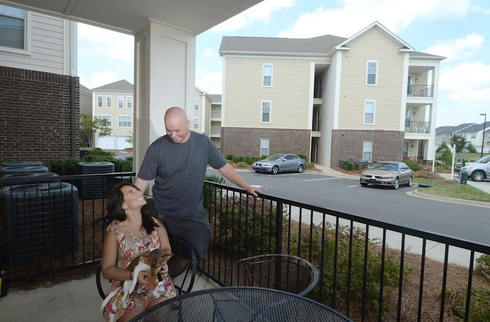 When Lina and Jimi Gibson moved into their 850-square-foot apartment in 2009, they figured they'd stay two years while they planned their wedding and saved for a house. Now, with the economy in another tailspin, they're on the fence. The couple can walk to restaurants and movies from their building in southwest Charlotte. They have a gym and a pool, and they don't have to mow the lawn or repair the roof. Mostly, they don't have to worry-like so many of their friends- that the housing market's slide isn't over. (Deidra Laird/Charlotte Observer/Tribune News Service via Getty Images)