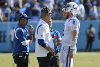 Indianapolis Colts quarterback Carson Wentz (2) talks with head coach Frank Reich and offensive coordinator Marcus Brady, left, in the second half of an NFL football game against the Tennessee Titans Sunday, Sept. 26, 2021, in Nashville, Tenn. (AP Photo/Mark Zaleski)
