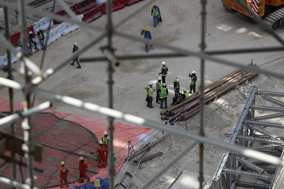 In this Oct. 8, 2019 photo, laborers work under the Al Wasl Dome at the under construction site of the Expo 2020 in Dubai, United Arab Emirates. The preparations for Expo 2020 come as Dubai's real estate market show signs of faltering amid global economic woes. Fears of military conflict across the Persian Gulf cloud organizers' sunny projections. (AP Photo/Kamran Jebreili)