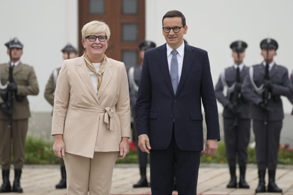 Lithuanian Prime Minister Ingrida Simonyte, left, being greeted by Poland's Prime Minister Mateusz Morawiecki on a visit for talks that include the region's security in the face of migrant pressure on the two countries' borders with Belarus, in Warsaw, Poland, on Friday, Sept. 17, 2021. (AP Photo/Czarek Sokolowski)