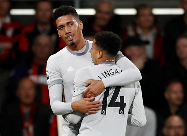 "Soccer Football - Premier League - AFC Bournemouth vs Manchester United - Vitality Stadium, Bournemouth, Britain - April 18, 2018 Manchester United's Chris Smalling celebrates scoring their first goal with Jesse Lingard Action Images via Reuters/John Sibley EDITORIAL USE ONLY. No use with unauthorized audio, video, data, fixture lists, club/league logos or ""live"" services. Online in-match use limited to 75 images, no video emulation. No use in betting, games or single club/league/player publications. Please contact your account representative for further details."